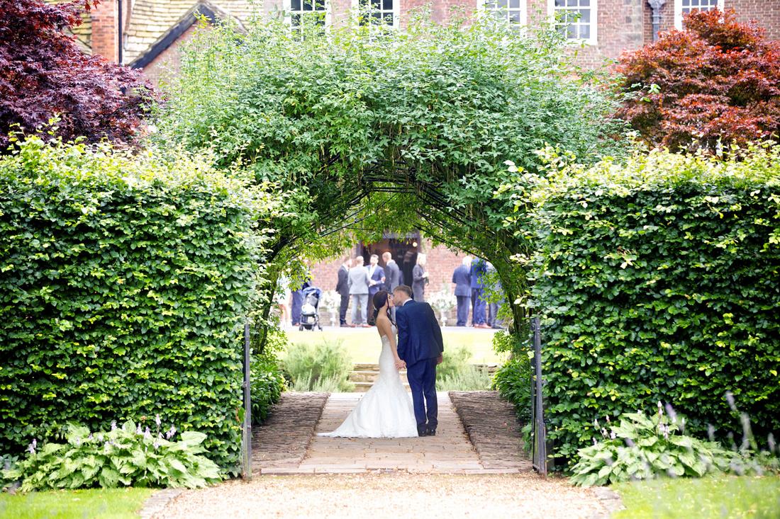 Laburnum arch wedding photo