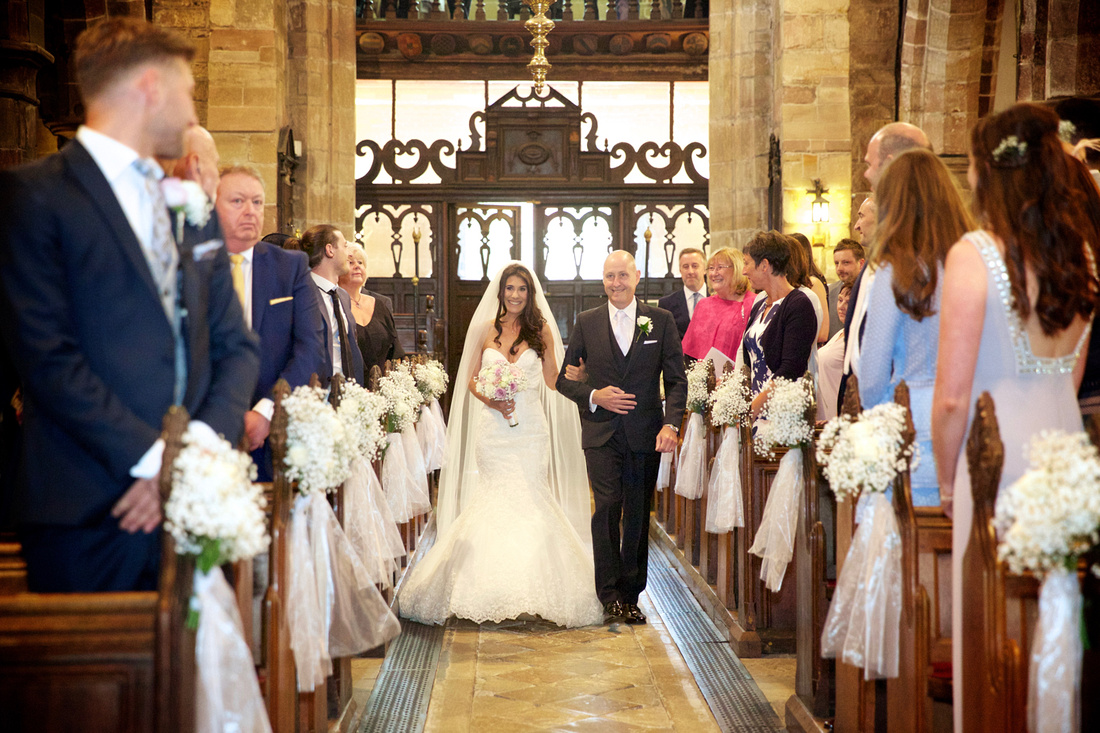 Groom seeing his bride for the first time at Prestbury church