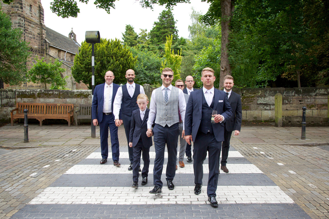 Boys in Whitfield and Ward suits before the wedding
