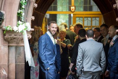 Groom welcoming the wedding guests arriving