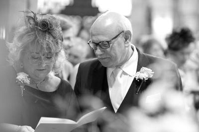mum and dad singing a wedding hymn