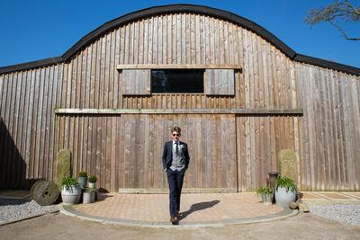 Blue wedding suit at Alcumlow Barn